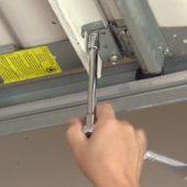 diy-garage-door-maintenance-tips-1-tighten-bolts