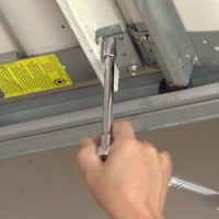 diy-garage-door-maintenance-tips-1-tighten-bolts